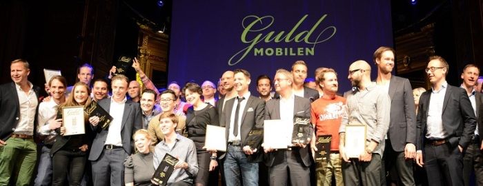 caption: Truecaller Team members standing amongst other Guldmobilen winning companies